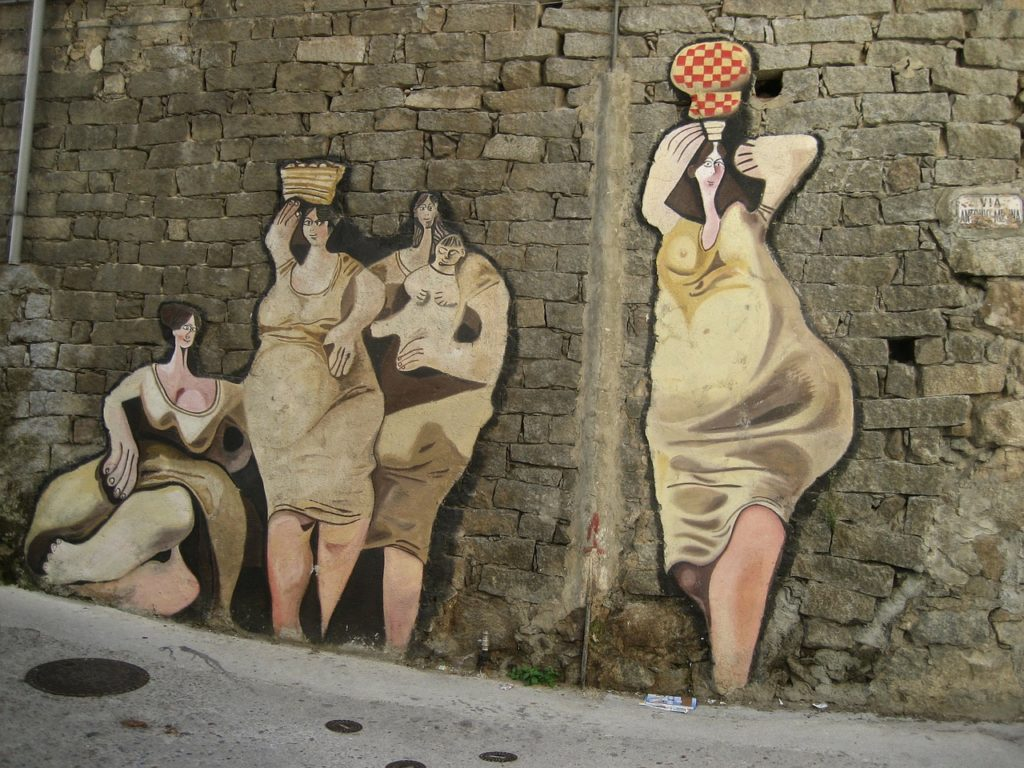 art on the walls of typical houses in sardinia