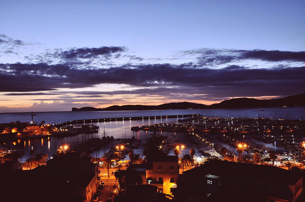 pictures of Alghero Italy Sardinia by night in an article about travel tips