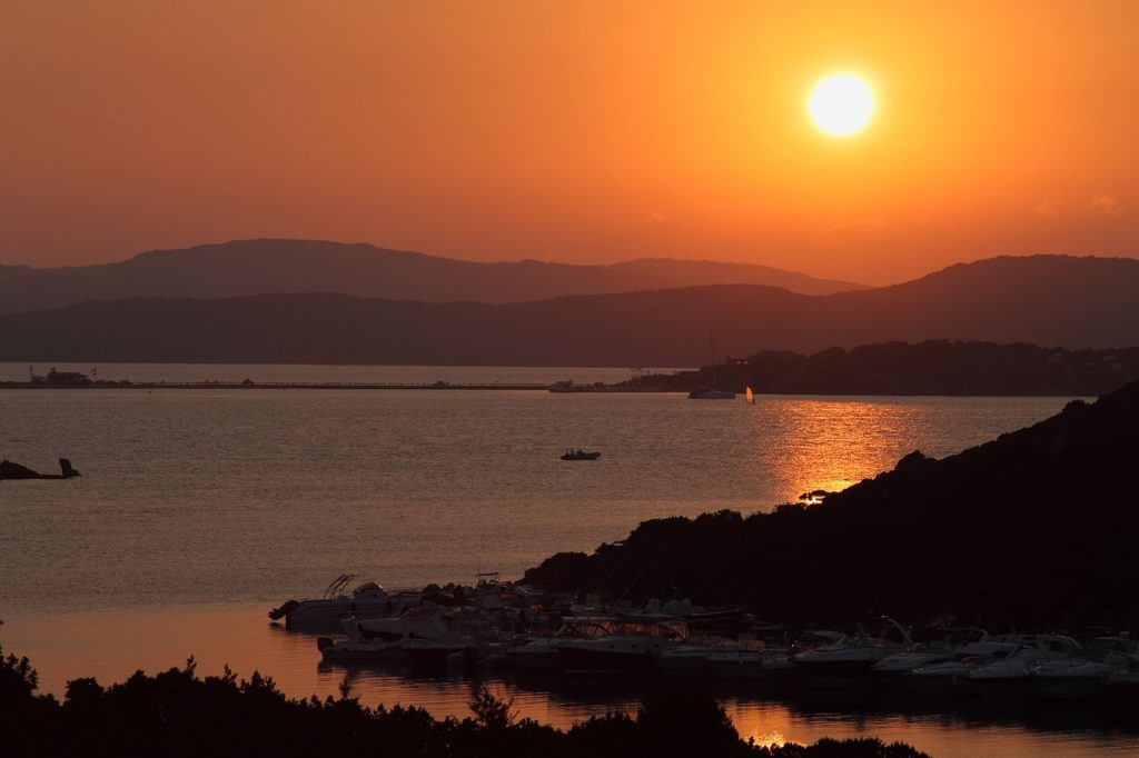 image of porto rafael, sardinia, at sunset