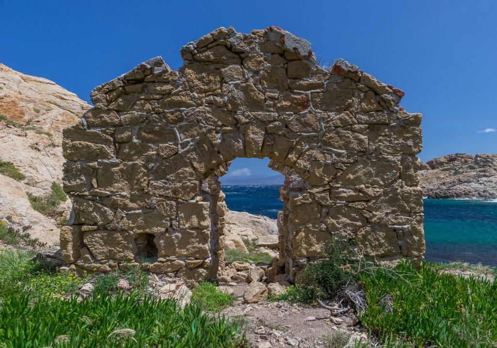 ancient door make of rocks on sardinian coast