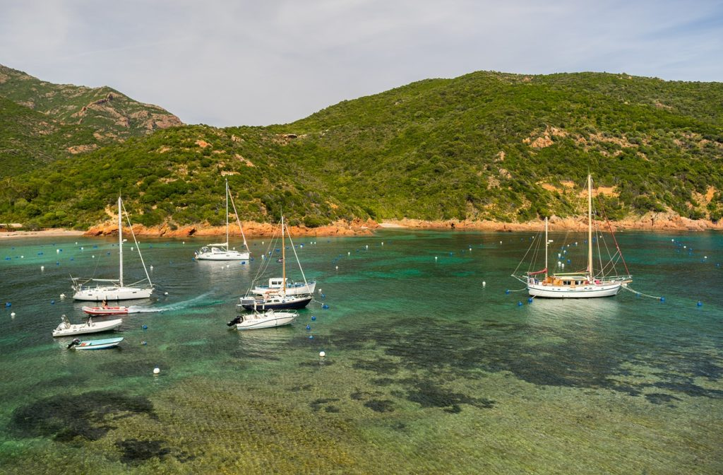 image of boats and sardinia coast