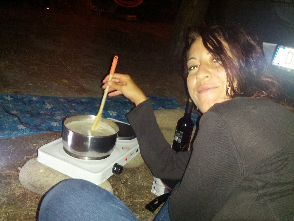 a girl cooking in a campsite in sardinia