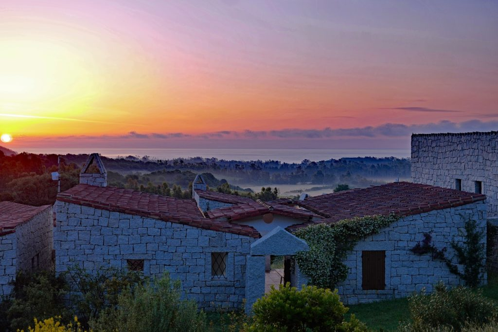 sardinia sunrises on houses