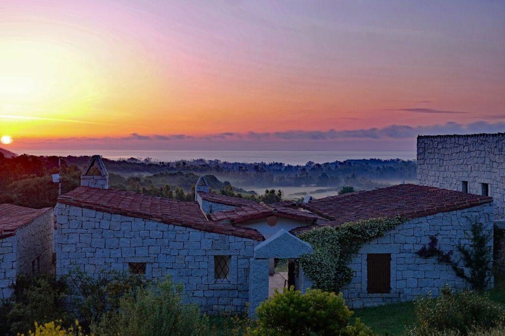 sardinia sunrises on houses