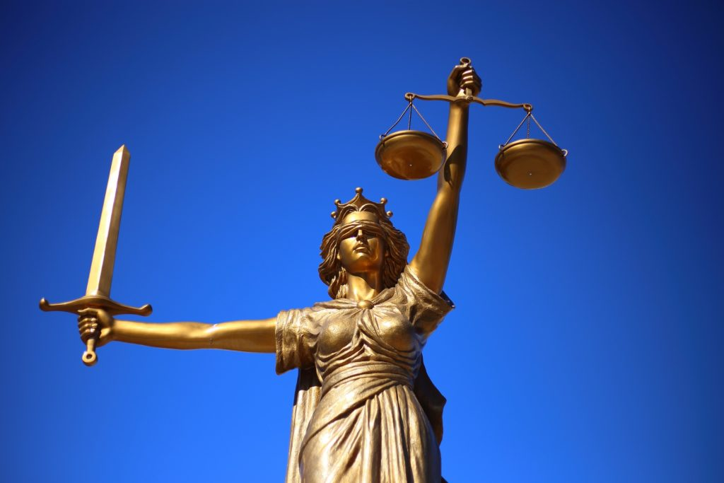 statue justice law insurance car hire